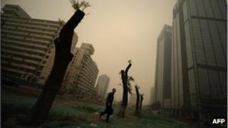A man walks through heavy pollution on a street in Beijing on November 1