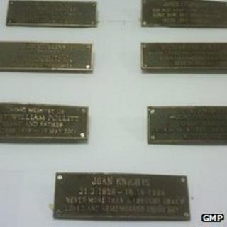 Nine bronze memorial plaques