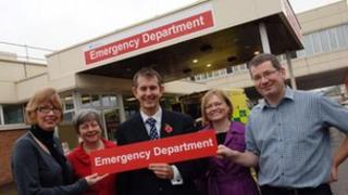Health minister Edwin Poots (centre) helped unveil the new signs