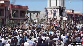 Demonstrators protesting against Syria's President Bashar al-Assad