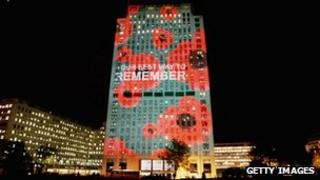 A building in London lit up with poppies