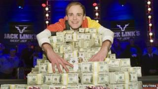 Pius Heinz of Germany poses with his World Series of Poker winnings in Las Vegas - 9 November 2011