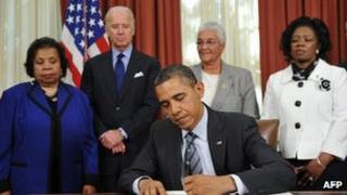 US President Barack Obama signs an executive order promote efficient spending 9 November 2011