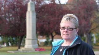 Helena Tym standing before Caversham war memorial