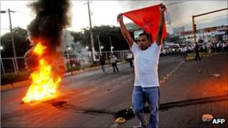 Nicaraguan opposition protesters beside a fire during protests in Managua against the election result