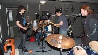 Young people playing in a band