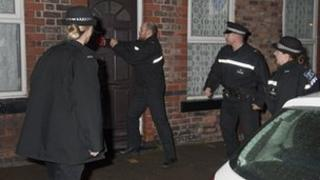 Police raid a house on Merseyside