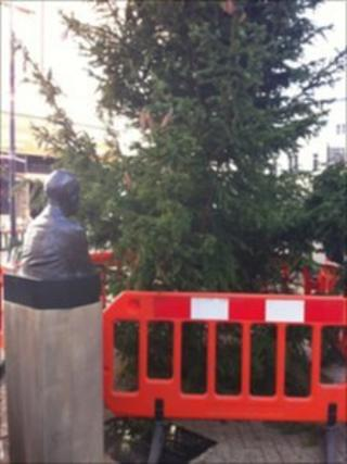 The statue of Trevor Huddleston and the Christmas tree