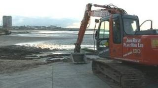 Clearing Margate beach