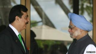 Pakistan's Prime Minister Yusuf Raza Gilani shakes hands with his Indian counterpart Manmohan Singh before the 17th South Asia Association for Regional Cooperation (SAARC) summit at the Shangri-Las in Addu