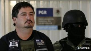 Ovidio Limon Sanchez presented to the media by masked soldiers in Mexico City