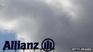 Allianz sign under dark clouds