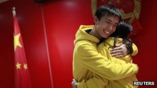 A Chinese couple hug after getting married in Shanghai on 11 November 2011