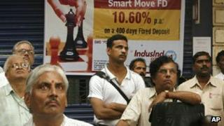 Indians outside the stock exchange in Mumbai