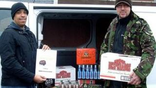 PC Ady Clarke (left) and PC Steve Browett in front of a van full of beer