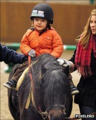 Oliver riding with his side helpers from RDA Wilby