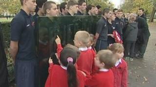 School children and memorial panels