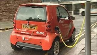 Electric car at a charging post