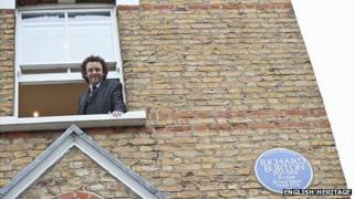 Michael Sheen looks out from Richard Burton's old house in Hampstead, north London