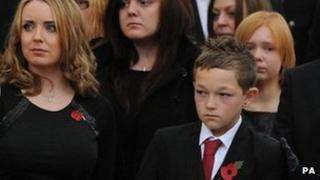 Helen and Ben Goodlad watch mark Goodlad's coffin leave the cathedral