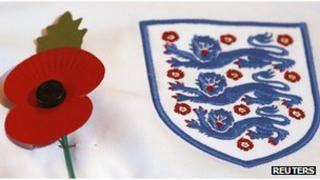A poppy on the shirt of England player Phil Jones during a news conference