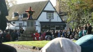 People gather on Remembrance Sunday in Prestbury
