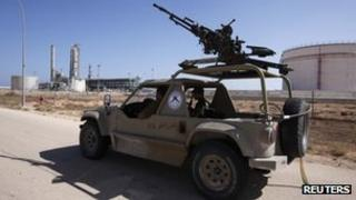 Armed guards at a Libyan oil refinery