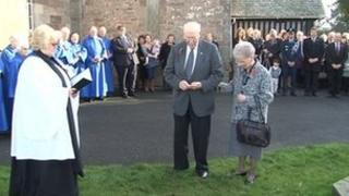 George Reseigh (centre) at the church when the memorial was dedicated