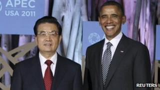 President Hu Jintao (L) and President Barack Obama at the opening dinner of the APEC Leaders Summit in Honolulu, 12 November 2011