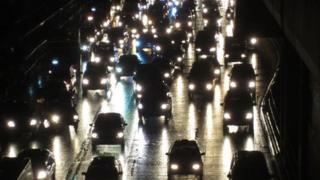 Traffic jam on a key road at night