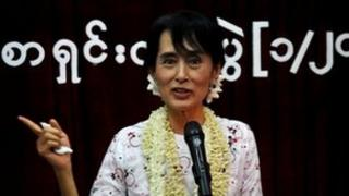Aung San Suu Kyi speaks at a press conference to mark the anniversary of her release from house arrest on 14 November 2011