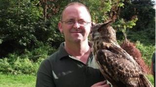 Avon Owls owner Darren Jenkins with an owl
