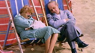 Couple snoozing by the seaside