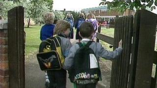 Children enter school grounds