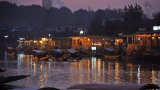 Kashmiri gondolas carrying tourists in Kashmir's famed Dal Lake in Srinagar