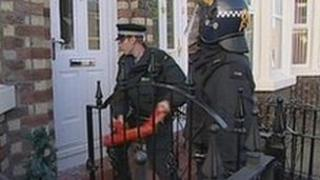 Police force their way into a home