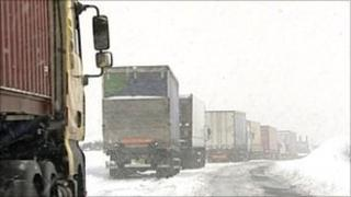 Lorries stuck in snow on A57