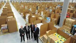 Alex Salmond joined Amazon's vice president of European operations Allan Lyall and Fife Council leader Peter Grant