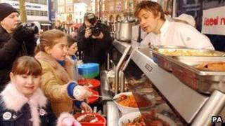Jamie Oliver feeds children