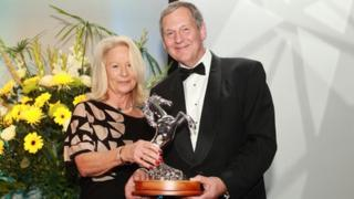 Bunny Roberts with David Buckton of South Essex Insurance Brokers who sponsor the Voluntary Service award