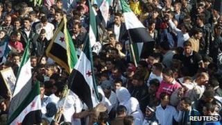Demonstrators protest against Syria's President Bashar al-Assad in Hula, near Homs. 13 Nov 2011