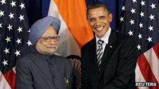 US President Barack Obama shakes with Indian Prime Minister Manmohan Singh on the sidelines of the ASEAN Summit in Nusa Dua, Bali, November 18, 2011.
