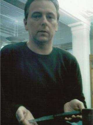 Tony Williams holding the knife belonging to Sir John Williams