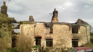 The fire-damaged farmhouse