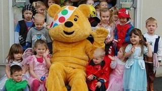 Pudsey Bear with Guernsey pre-school children
