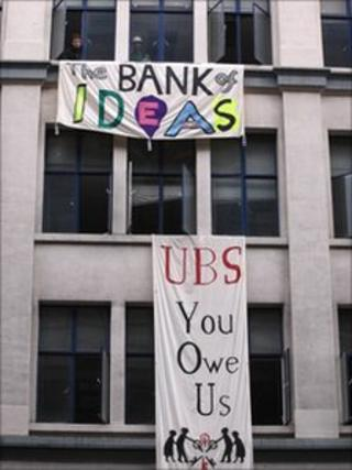 Occupy London banners outside empty UBS office