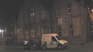 Police van outside the Asia restaurant