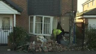 House damaged by car