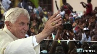 Pope Benedict XVI waves to crowds in Benin's main city Cotonou on Saturday