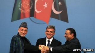 (L to R) Afghanistan's Karzai, Turkey's Gul and Pakistan's Zardari